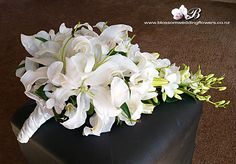 white lily and blue orchid bouquet | lily-orchid-cascade