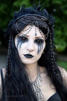 She's Pretty.. Gothic.. & creepy all at the same time / makeup idea paired with possessed style FX contacts => http://www.pinterest.com/pin/350717889705707881/