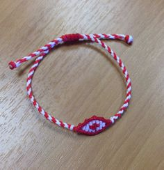Red and white march eye bracelet
