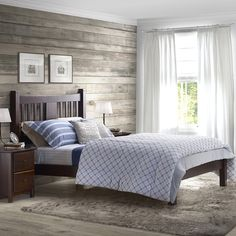 I don't really care for the bed, but I love the wood wall, light paint and curtains.
