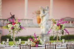 Floral arrangements in vintage candelabrum with crystals at this glamorous wedding at the Ringling Museum.