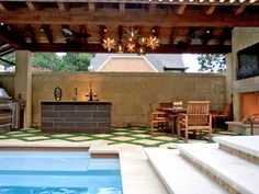Love the touches of grass.... low maint.  Outdoor Living Room - Outdoor Kitchens That Sizzle on HGTV