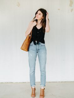 """To be honest, these mom jeans are still tricky for me. Sometimes I'm just not sure how to style them. Getting the proportions to feel """"right""""is where I have the most trouble. But…"""