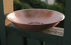 "Monarch's pure copper hand hammered basin offers a complementary look to your rain chain while enhancing your outdoor space. Measures 21"" in diameter."