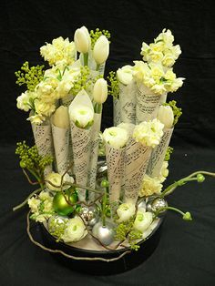 Flower arranging with Christmas Carol music www.floraldesignm... #DIYChristmasarrangement #Christmastable #flowers