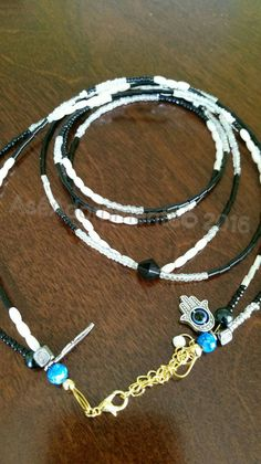 Check out this item in my Etsy shop https://www.etsy.com/listing/271467029/balck-and-white-waist-beads-waist-eleke