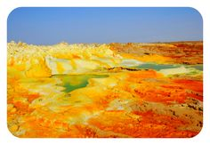 //It looks like Hell on earth. This is the Dallol volcanic crater, located in Ethiopia. Being the hottest place on the planet, Dallol has been formed by the intrusion of basaltic magma and hydrothermal activity. Sulfur, salt and other minerals color the crater yellow, green and red.
