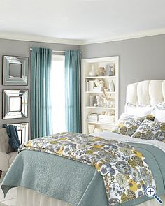 grey, yellow, teal! love the grey walls and teal curtains.