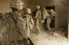 Warrior Wednesday: U.S. Marines with Charlie Company, 1st Battalion, 6th Marine Regiment, 24th Marine Expeditionary Unit, search a village for suspected Taliban in the Garmsir district or Helmand province, Afghanistan in June 2008. www.devildoggraphix.com