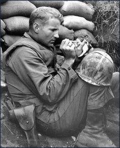 World War II soldier feeds orphaned kitten