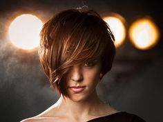 Google Image Result for http://slodive.com/wp-content/uploads/2012/03/short-layered-hairstyles/partially-face-covered-brown-hair.jpg    Like the color