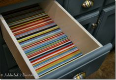 Lining a drawer with fabric.  Who needs icky Contact paper?