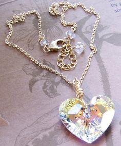 Handmade necklace with large wire-wrapped faceted clear AB Swarovski crystal heart (28mm) on 14kt gold filled chain with lobster clasp and rock quartz gemstone at neck. Adjustable 16 - 18 L.  More Swarovski Necklaces: https://www.etsy.com/shop/JewelryBySS?ref=hdr_shop_menu&section_id=19095675 ________________________________________________________ Packaged in an Elegant Silver Gift Box with a Silver Ribbon Bow.  Ships within 4 business days. ________________...