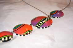 Hollow polymer clay beads strung into asymmetrical necklace.