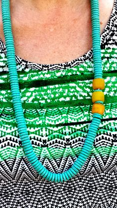 Turquoise and African glass bead asymmetrical necklace.