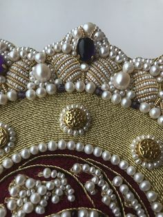 Work by Larissa Borodich. Detail. New frame. Goldwork and pearl embroidery. Silk embroidery. Pearls, amethysts, garnets, silk thread, gold thread, check purl, cords, etc. Size 10x13 inches, 26x32 cm.