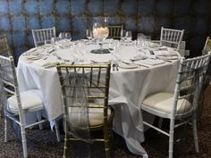 Wedding breakfast set up with silver organza sashes.  Want your own quote? Then email me with your ideas! hello@beckiemelvinevents.co.uk  More styles can be seen at www.beckiemelvinevents.co.uk