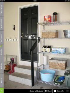 Boot storage in garage. Painted door with number and steps.
