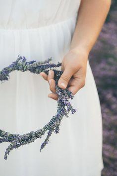 Bride holding a lavender flower crown