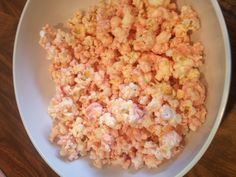 Pink strawberry princess popcorn Pop plain or home style popcorn remove all unpopped kernels, melt white chocolate and one packet of strawberry shortcake frosting creations. Mix with popcorn in a large bowl lay flat on wax paper to dry.