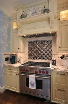 love the backsplash tiles (quilt-look?), love the WOLF range, love the cabinet color/hardware...countertop can be different--not digging it.