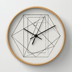 This wall clock is 10 in diameter and features a black and natural hexagon print which is my own design. By Olaf Designs Studio.