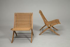 """""""X-Chair"""". Laminated, moulded mahogany frame with bird's eye wood inlays. Seat and back with woven cane. Model 6135. Designed circa 1958 by Peter Hvidt, Orla Mølgaard-Nielsen. Produced by Fritz Hansen."""