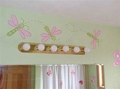 pink and green painted dragonfly mural for girls room