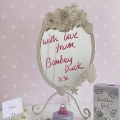 Shabby chic flowers oval mirror, with substantial metal frame that is painted in a chalky matt cream, with pretty painted metal flowers, tendrils and leaves. In my eyes it is hardly distressed at all so could be distressed further. Love bombay duck! afflink for eBay!