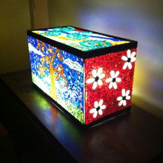 Mosaic light box made out of old fish tank.