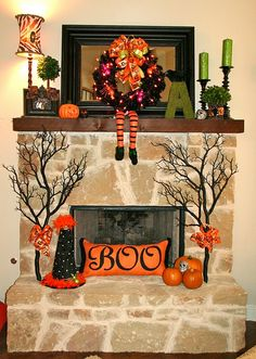 Inspired! Spray black paint on branches and put on the hearth.  Just what I need to complete the spooky look!