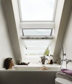Open up the roof and use the space under the #roofwindows for a super-relaxing bathtub. See more bathrooms floating in light here: http://www.velux.com/products/be_inspired/gallery/bathroom