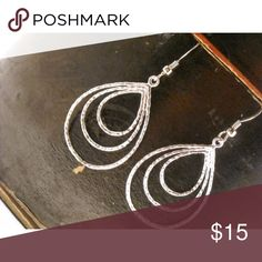 """Loop earrings Loop earrings These silver dangle earrings are light in weight.  They measure 1 1'2 long and an 1"""" at the longest.  They are made of sterling silver plated Rhodium that is tarnish resistant.    This are simply stated and never will go out Jewelry Earrings"""