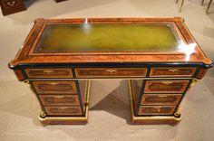 An exhibition quality Victorian Period burr walnut, kingwood and ormolu mounted writing desk.