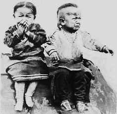 Two Osage children, Osage Reservation, Oklahoma. Photo: no date. Due to the quality of this photograph I guess it would be quite old. And they're not very happy at all!