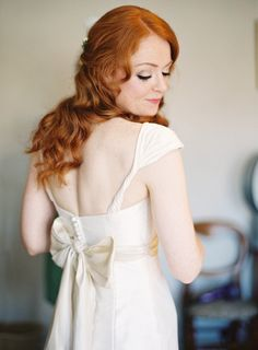 beautiful bow at the back of this cap sleeved wedding dress / Depict Photography