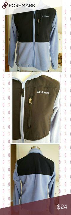 "Columbia fleece jacket Fleece jacket with inserts of windbreaker fabric Zipper closure  3 zippered pockets Adjustable hem Elastic sleeve bottoms  23"" long 20.5"" bottom width Sleeve 24"" Pretty periwinkle blue and black Columbia Jackets & Coats"