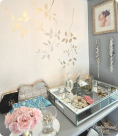 beautiful closet makeover by centsational girl - she made her own closet look like a boutique! i love the metallic painted leaves, the gray and pink combo, flowers... i just need a walkin closet :)