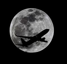 AN AIRLINER CROSSES THE MOON'S PATH MONDAY APRIL 14, 2104 ABOVE WHITTIER CALIFORNIA APPROXIMATELY ONE HOUR BEFORE A TOTAL LUNA ECLIPSE. THEN, ON APRIL 29, THE SOUTHERN HEMISPHERE WILL BE TREATED TO A RARE TYPE OF SOLAR ECLIPSE, IN ALL, FOUR ECLIPSES WILL OCCUR THIS YEAR, TWO LUNAR AND TWO SOLAR