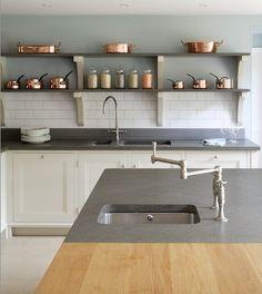 Bespoke cook's kitchen in oak with Italian black basalt.  Designed and made by Artichoke www.artichoke-ltd.com
