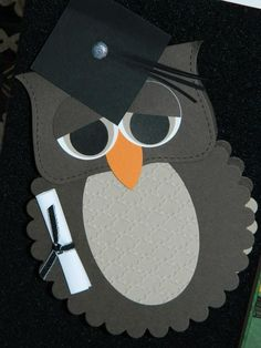 handmade graduation card from Stella McKay ... huge punch/die cut art owl ... mortar board and rolled diploma ... black, grays and white with a pop of orange ... adorable card ... just look at those eyes!!! ... Stampin' Up!