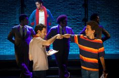 """Adam Chanler-Berat and Kyle Beltran (foreground, left and right) in """"The Fortress of Solitude,"""" at the Public Theatre. In """"The Fortress of Solitude,"""" director Daniel Aukin tries """"to bring depth to the American musical—a very worthy task—but forgets the sequins."""" Hilton Als reviews the new production: http://nyr.kr/1pJdYAV (Photograph courtesy Doug Hamilton / The Public Theatre)"""