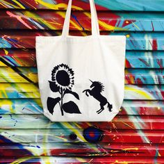 Stand out from the crowd wearing one of Grafeeq's hand painted and quirky designs. These quality cotton tote bags are lined for extra strength, ideal for carrying books, shopping or as a gym, beach or uni bag. Uni Bag, Cotton Tote Bags, Reusable Tote Bags, Gym Gear, Unicorn, Hand Painted, Unicorns, Gym Wear