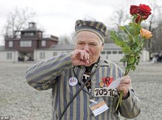 Emotional: Former National Socialist concentration camp survivor Petro Mischtschuk, 87, cries while holding roses in his hand during a commemoration for the 68th anniversary of the liberation of Buchenwald in Germany.