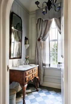 subdued palette, love the cornice and the antique vanity...in Sea Island Georgia by David Guilmet Design