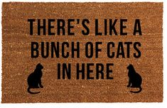 Custom hand painted welcome mat with the phrase Theres like a bunch of cats in here Made from coir, a 100% natural, bio-degradable coconut fiber product. Each rug is custom painted therefore no 2 will be exactly alike. Each rug is painted with a black dye for durability and sealed with an