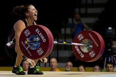 Venezuela's Yusleidy Figueroa Roldan shouts after struggling on a lift attempt in the women's 58kg weightlifting at the Pan Am Games in Oshawa, Ontario on Sunday, July 12, 2015.