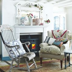 Shabby chic living room  This look is kept classic with a simple neutral armchair and floral cushions, with an old-style rocking chair and a classic Aubusson rug.
