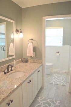 Contemporary Full Bathroom with Giallo Napoleone, Granite By Arizona Tile, Undermount sink, Simple Granite, Wainscotting