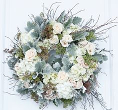 Elegant white, cream, ivory and dusty miller holiday door wreath by Nature of Design with Janet Flowers